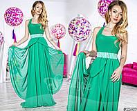 Вечернее/выпускное платье приталенного силуэта с легкой шифоновой юбкой и украшением на талии.