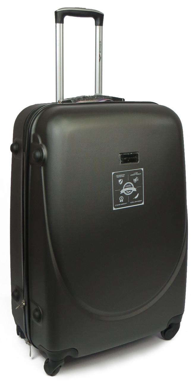 Cредний 4-х колесный чемодан из ABS пластика 63 л. Wings Wp00069 black