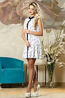 Легкое белое платьице с расклешенной юбкой