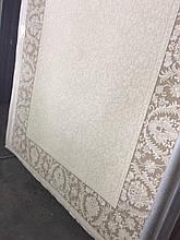 Бавовняний килим з бежевою облямівкою і світлою серединою