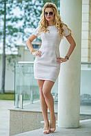 Платье облегающего силуэта. Выполнено из турецкого жаккарда с мелкими пайетками.