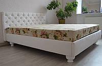 Кровать в мягкой обивке