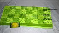 Комплект зелених рушників в клітинку