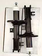 Амортизатор подв. DAEWOO Nubira 97- задний  лев. масл. RIDER