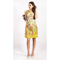 Стильное желтое платье с ярким орнамернтом