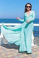 Элегантное платье в горошек с рукавом