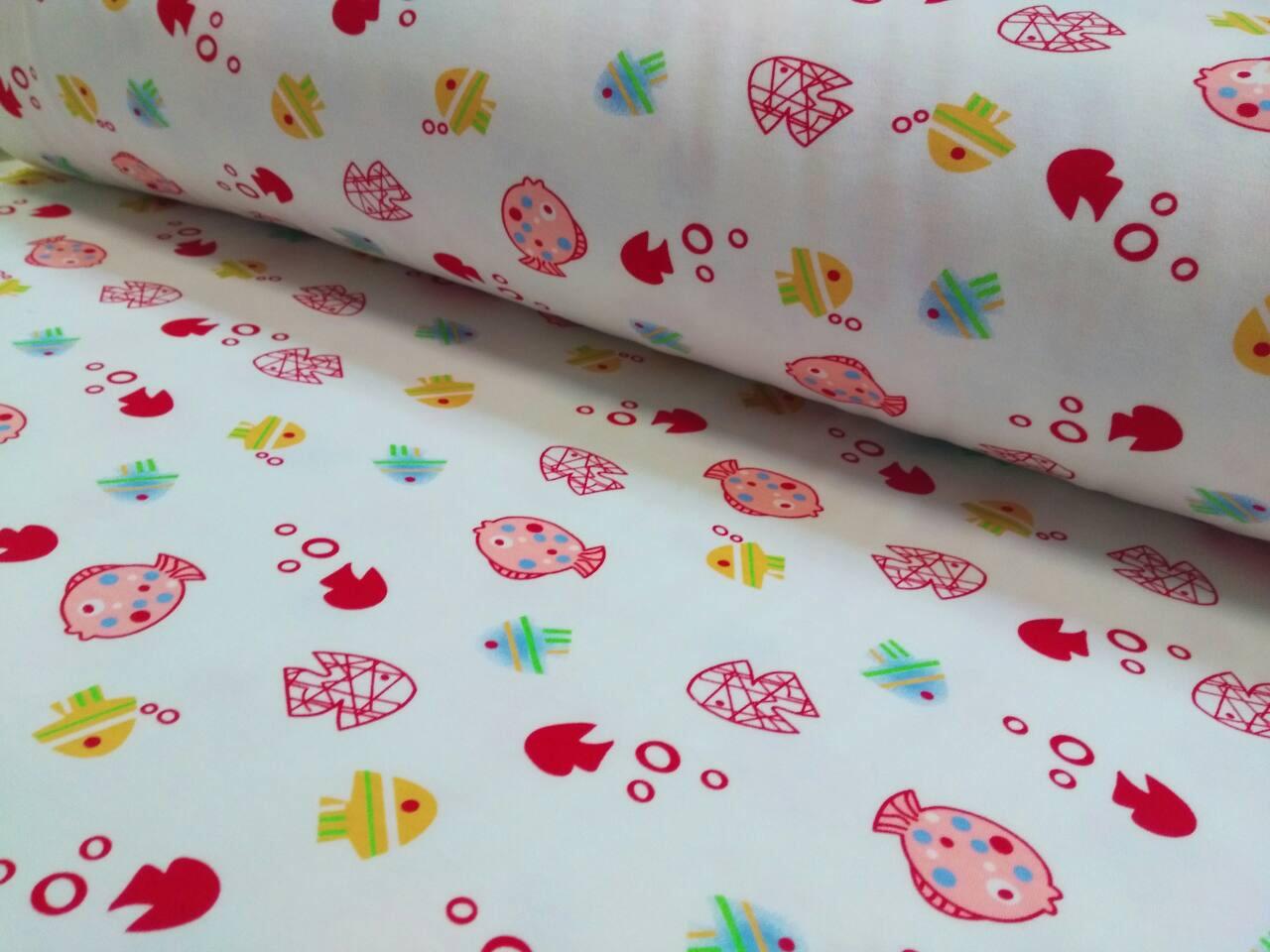 Трикотажная ткань рыбки розово-желтые на белом