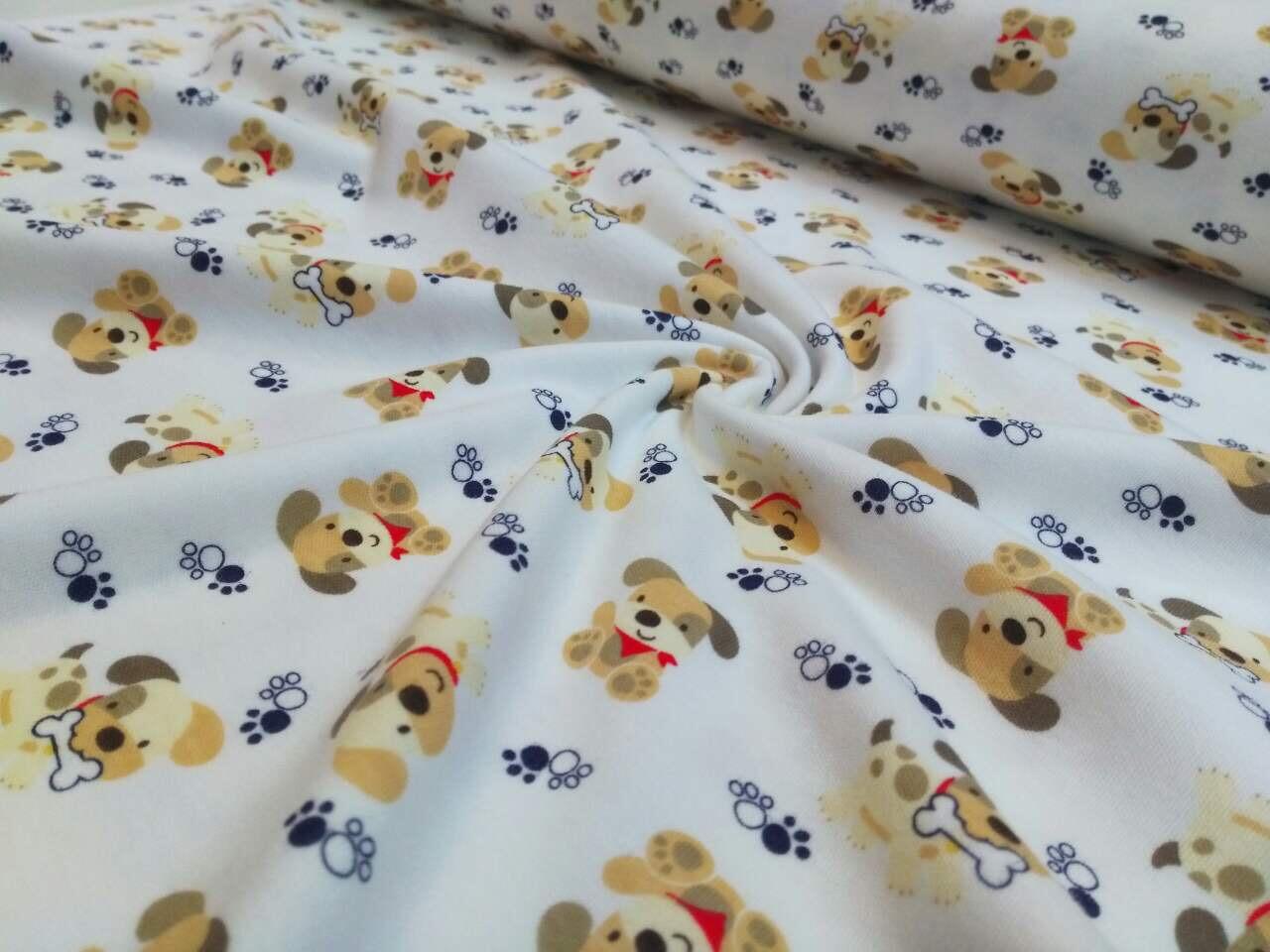 Трикотажная ткань собачки бежевые и лапки на белом