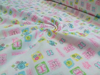 Трикотажная ткань бабочки и цветы розово-желто-бирюзовые на белом