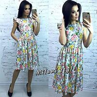Женское платье по колено цветы