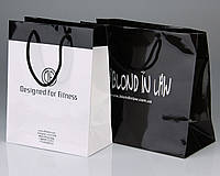 Изготовление пакетов бумажных с логотипом  для спортивной одежды