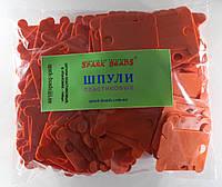 Шпули пластиковые (140 шт). Цвет - оранжевый, фото 1