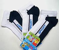 Спортивные детские носки белого цвета с темно-синей стопой