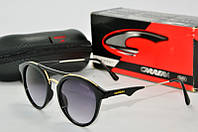 Солнцезащитные очки круглые Carrera черные