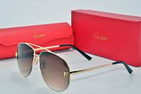 Солнцезащитные очки Cartier коричневые