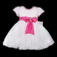 Праздничное белое детское платье с блестящим верхом и розовым бантом