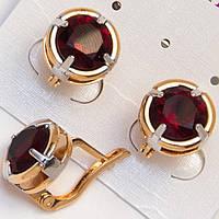 Серьги золотистые красные камни