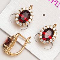 Серьги золотистые с красными камнями