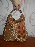 Шикарная тканевая сумка с ручками кольцами