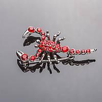 Брошь серебристая Скорпион красные стразы 4,5*2см