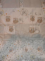 Органайзер с карманами на кроватку из ткани