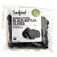 Sunfood, Сертифицированные натуральные оливки сорта Black Botija, без косточек, с зеленью, 8 унций (227 г)