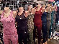 Женские спортивные майки Nike