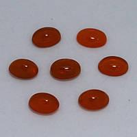 Опал оранжевый кабошон 5х7 мм. 0,40 карат