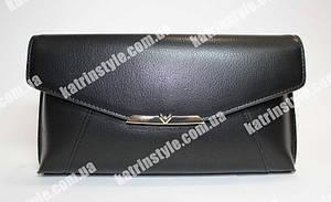 Женский клатч черного цвета