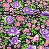 Ткань с розовыми и фиолетовыми цветами на черном фоне