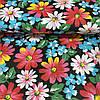 Ткань с разноцветными цветами на черном фоне