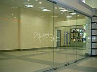 Двойные распашные двери с глухими частями (цельностеклянные конструкции)