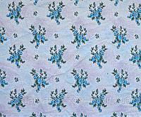 Ткань постельная Яблоневый цвет голубой на красном напылении
