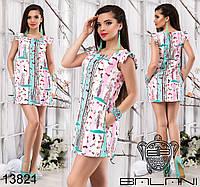 Короткое платье свободного силуэта с карманами по бокам, декорированное оригинальным принтом.
