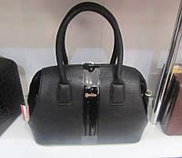 Черная женская сумка с лаковами вставками