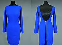 Красивое женское платье с отделкой из перфорированной экокожи