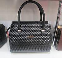 Небольшая женская сумочка черного цвета
