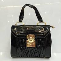 Маленькая стеганая сумочка черного цвета