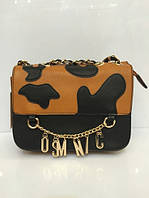 Модная сумочка-клатч с ярким зоо-принтом