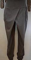 Стильные серые брюки на запах с карманами. Италия