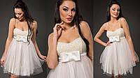 Элегантное женское платье с пышной фатиновой юбкой, пояс украшен бантиком. Цвет молочный
