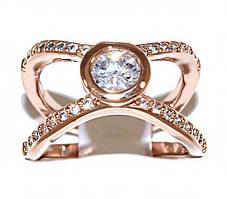 Кольцо  фирмы XР. Цвет: позолота с кр.от. Камни: белый  циркон.Ширина кольца: 1,2 см. Размеры:15,5; 16,5;