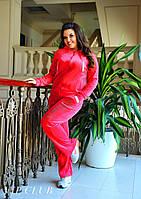 Спортивный костюм из велюра, кофта на молнии декорирована стразами на спине, штаны с карманами.