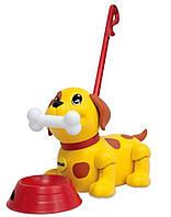 Игрушка-каталка Веселый щенок Tomy  (T72376)