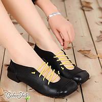 Кожаные туфли черные на низком каблуке