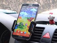 Автомобильный держатель для телефона в вентиляционную решетку.