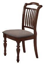 Дерев'яні стільці з м'якою оббивкою