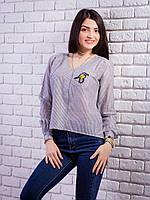 Женственная блуза с трендовым принтом в полоску