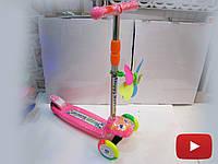 Самокат трехколесный детский розовый с флюгером