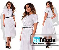Привлекательное женское платье в горошек белое